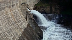 Waterfall Flows out of Concrete Dam along Cascade Steps Stock Footage