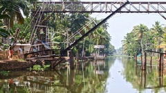 Motion along River under Drawbridge Suspended Bridge in Tropics Stock Footage