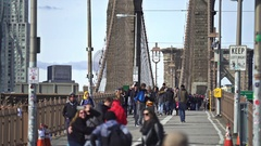 Crowd of people on Brooklyn bridge walkway - Manhattan, New York city Stock Footage