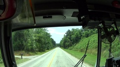 Firefighter in fire truck talking on radio pov Stock Footage