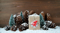 Christmas and New Year background with snow, pine cones, present with red fir Stock Footage