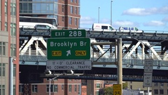 Manhattan bridge overpass and Brooklyn bridge sign - New York cityscape Stock Footage