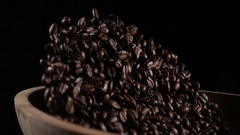 Coffee beans throw up in a wooden bowl Stock Footage