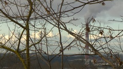 Air pollution by smoke coming out of the factory chimneys in the industrial zone Arkistovideo