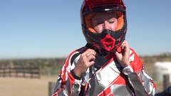 A young woman bmx rider putting on helmet. Stock Footage