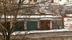 Old garages under the trees Stock Footage