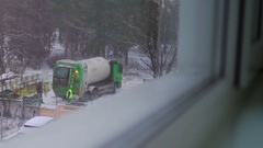 City public works trash truck loading garbage in winter Stock Footage