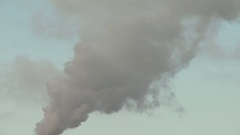 Air pollution by smoke coming out of the factory chimneys Stock Footage