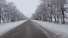Driving on a snow covered lonely rural road. Stock Footage