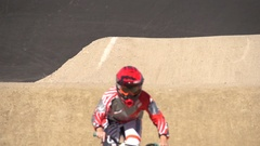 A young woman bmx rider riding on a dirt track , super slow motion. Stock Footage