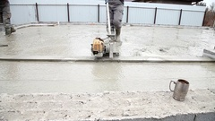 Pouring concrete mix from cement mixer on concreting Stock Footage