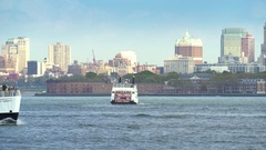 Statue cruises on Hudson river - New York Stock Footage