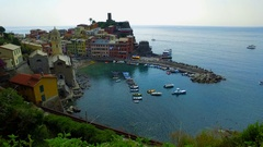TILT UP View from high hill of Vernazza houses and blue sea, Liguria, Italy Stock Footage