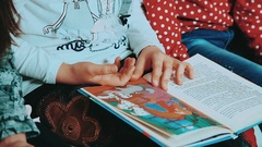 Book of fairy tales for children. Girl leafing through the pages of the book Stock Footage