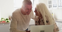 Excited senior couple looking at a laptop together Stock Footage