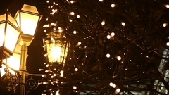 Street lamps in the snow at night Stock Footage
