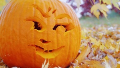 Close-up face carved into a pumpkin. Halloween symbol Stock Footage