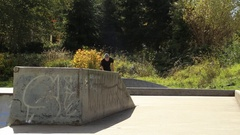 A young skateboarder going off ramps at a skate park. Stock Footage