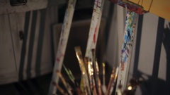 Various paintbrushes soiled with paints closeup Stock Footage