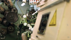 An old machine producing plastic packaging Stock Footage