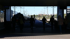 Passengers hurry to shuttle train, black silhouettes run at passage to platform Stock Footage