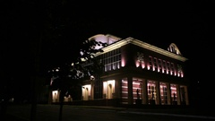An exterior of a theater at night Stock Footage