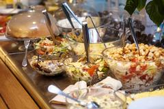 Bowls with various food in self service restaurant Stock Photos