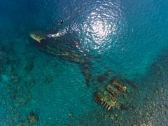 Freediver and ship wreck Stock Photos