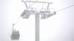 Installation of the cable car that transport skiers and ski slopes at Stock Footage