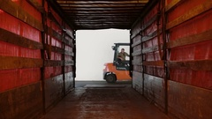 Man on a loader with boxes on it getting into a tunnel in truck Stock Footage