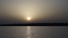 Video made on a boat traveling in a Malian lake at sunset. Stock Footage