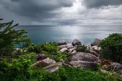 Dark clouds over the sea Stock Photos