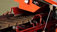 Detail of an assembly line. About construction, industry, sand, platform Stock Footage