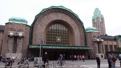 Helsinki central railway station, people cross road against main entrance Stock Footage
