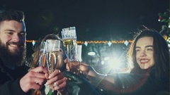 Four friends with champange glasses celebrating Stock Footage