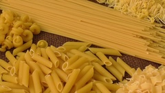 Variety of types and shapes of Italian pasta Stock Footage
