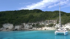 Laguna with blue water and white rocks which is anchored a catamaran  Stock Footage