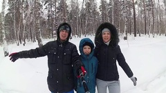 The family falls in the snowdrift. Selfie with monopod Stock Footage