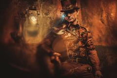 Portrait of steampunk man with various mechanical devices on vintage steampunk Kuvituskuvat