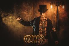 Steampunk man with Tesla coil on vintage steampunk background Stock Photos