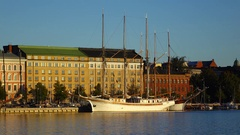 White sailer ship moored against urban embankment, early morning view Stock Footage