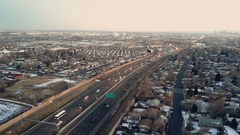 HIghway traffic of I25 highway with the downtown Denver skyline in the very far  Stock Footage