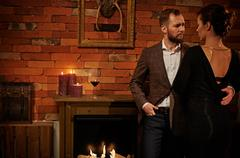 Well-dressed couple in cozy home interior Stock Photos