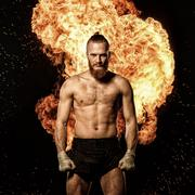 Professional fighter with fire on background Stock Photos