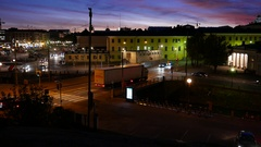 Small night traffic, truck move from bridge, city buildings and dusk sky Stock Footage