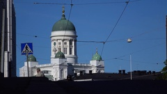 Motorcycle silhouette ride towards against white Helsinki Cathedral, telephoto Stock Footage
