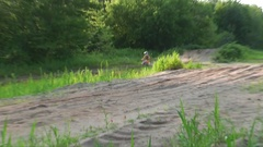 Motocross racer jumping past camera view Stock Footage