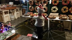 People visit Christmas market at main square in old city Stock Footage