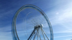 White Ferris Wheel time lapse shot, turn and stop, motion blur Stock Footage