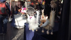 Soft toys displayed for sale on a market. Greenwich, London, United Kingdom Stock Footage